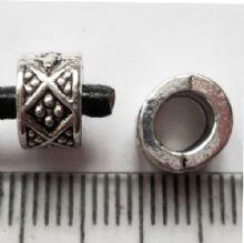 Tibetan Silver bead with 4.7mm hole. 8mm diam. 5mm wide